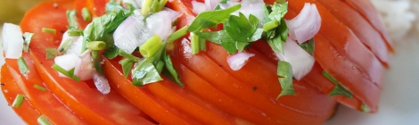 Germaine's tomato salad: thinly sliced tomato, dressed in vinegar and garnished with shallots, chives, and parsley