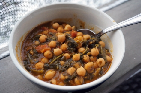 Chickpea stew with Ethiopian flavors, sitting on a porch rail. The snow-covered ground is visible behind it.